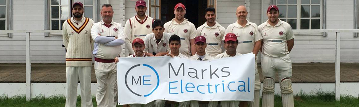 Cricketers hold up sponsor sign
