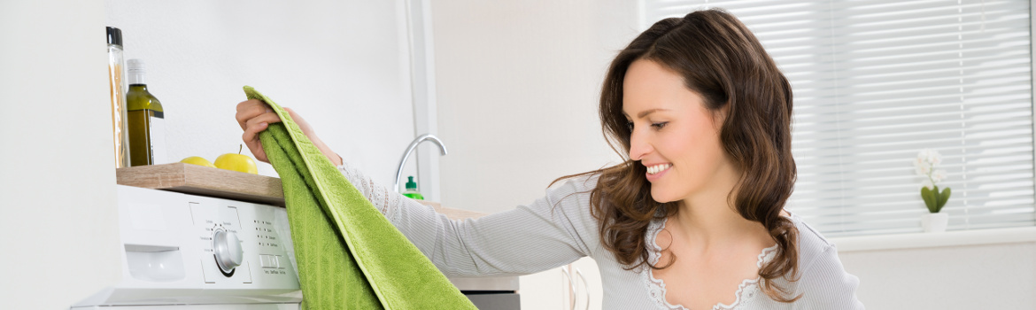 Woman impressed with expertly dried laundry